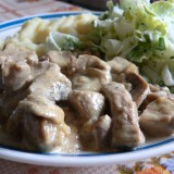 Pork fillet with mustard sauce, garlic and mushrooms