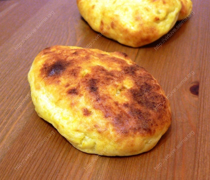 Boiled potato pancakes with cabbage filling