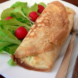 Crepes stuffed with broccoli and cheese